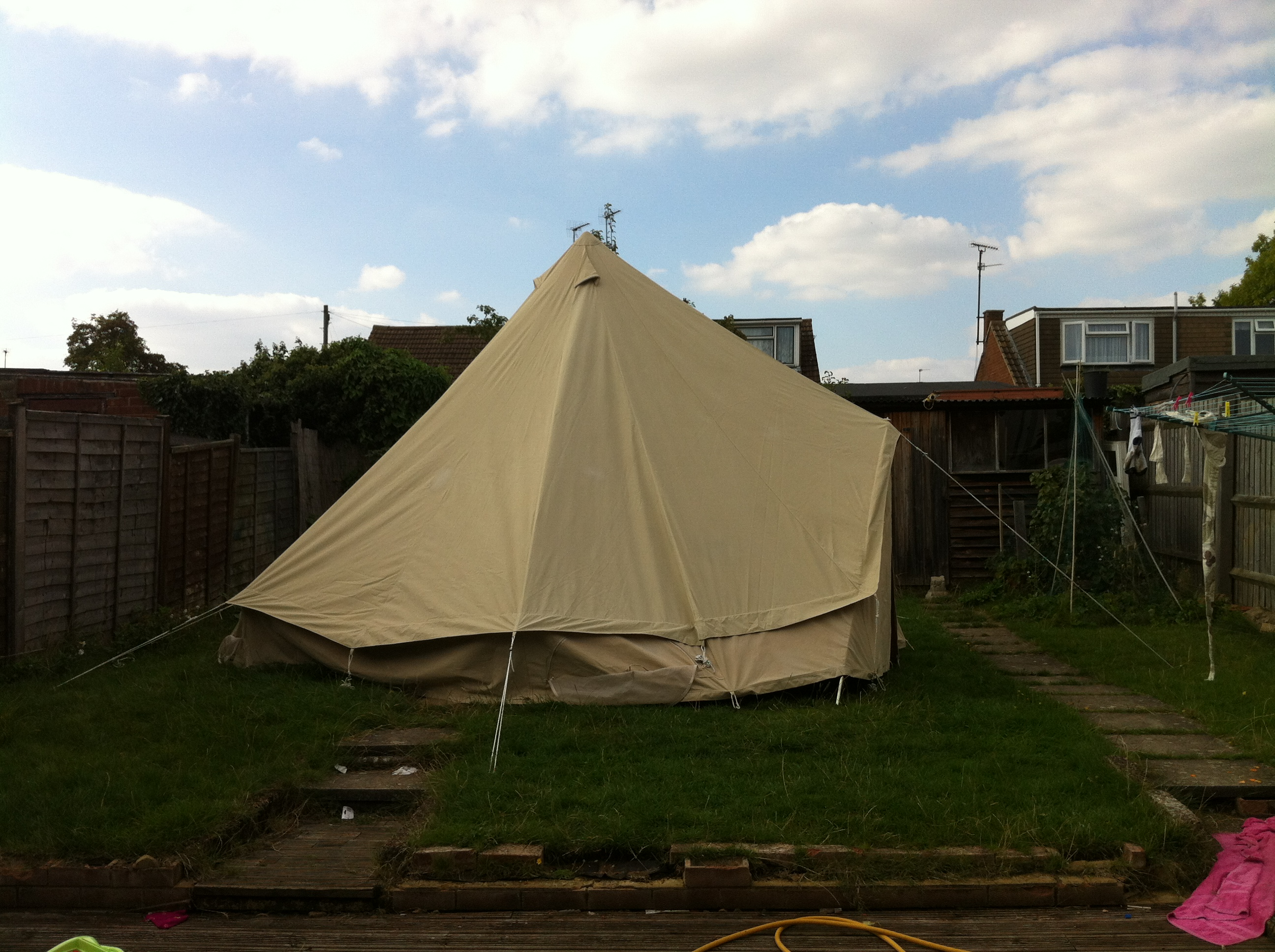 My friend and I scrubbed the mildew on my tent and put on some reproofing solution. The kids popped in now and then. & bell tent | Reclaiming Harmony